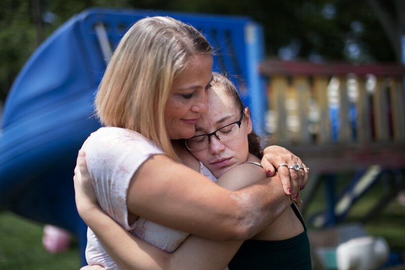 Destini Johnson gets a hug from her mother. She was released unexpectedly early because, she tells her parents, the jail was overcrowded. (Seth Herald for NPR)