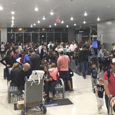 Miami's airport is packed on Thursday as residents and tourists evacuate the southern part of the state. (Shawn Woodward/AP)