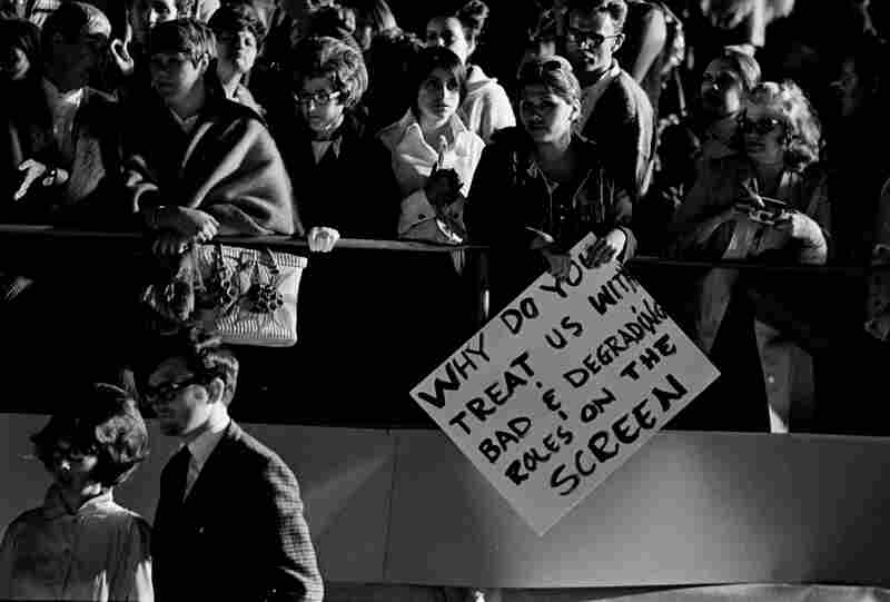 Protestors outside the 42nd Academy Awards, Hollywood. Circa 1970.