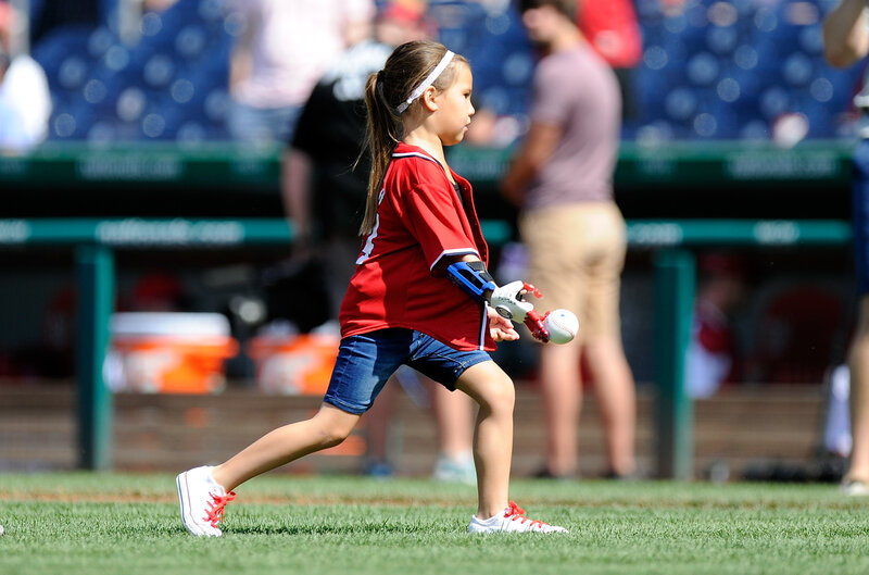 Image result for Girl with robotic hand on a mission to throw out first pitch at every MLB stadium