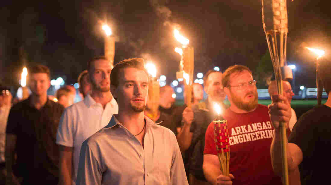 White supremacists march with tiki torchs through the University of Virginia campus. (Photo by Zach D Roberts/NurPhoto via Getty Images)