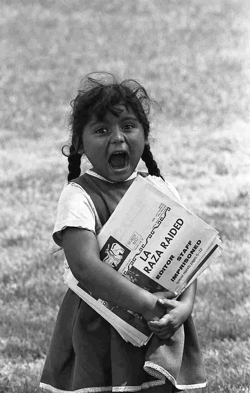 A young Chicanita hawks La Raza newspapers at the Poor People's Campaign, Washington, D.C. May–July 1968.