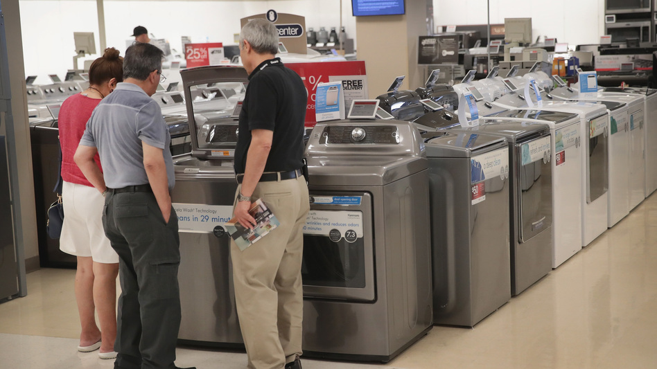 Shoppers look at appliances at a Sears store in Schaumburg, Ill. At nearly $13 trillion, consumer debt has topped the previous record set during the financial crisis.