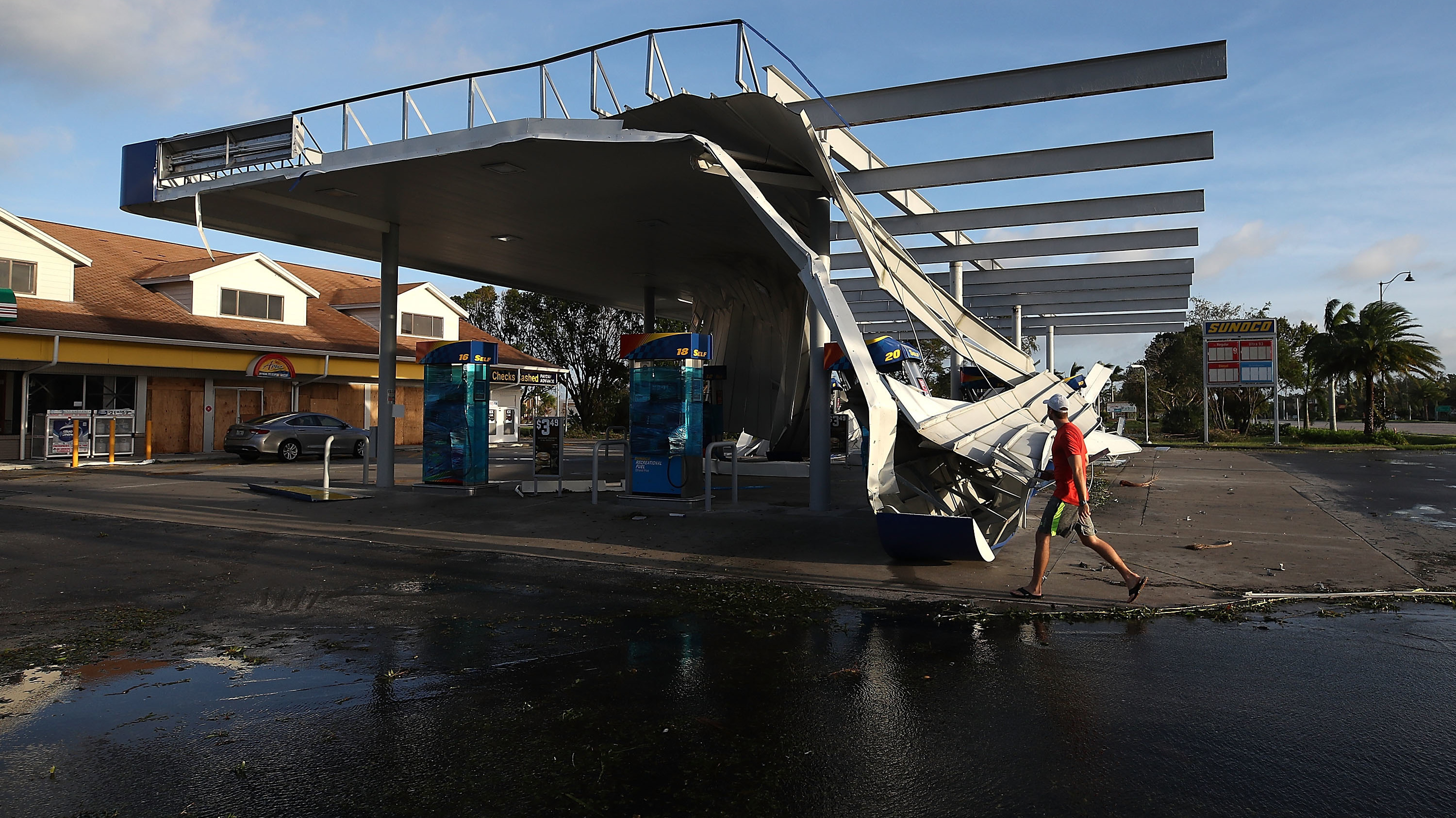 Hurricane Irma's winds tore up the roof of a gas station in Bonita Springs, Fla., as seen in this photo from Monday. (Mark Wilson/Getty Images)