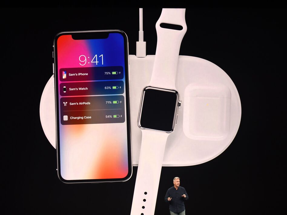 Apple executive Philip Schiller presents a wireless charging system, displayed with the new iPhone X and Apple Watch alongside cordless headphones called AirPods. (Josh Edelson/AFP/Getty Images)