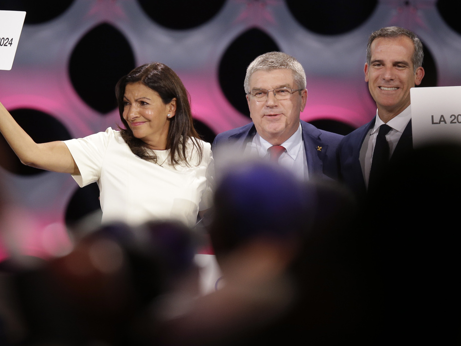 Paris and Los Angeles have been awarded the honor of hosting the 2024 and 2028 Olympic games, respectively. Pictured above: IOC President Thomas Bach (center), Paris Mayor Anne Hidalgo (left) and Los Angeles Mayor Eric Garcetti.