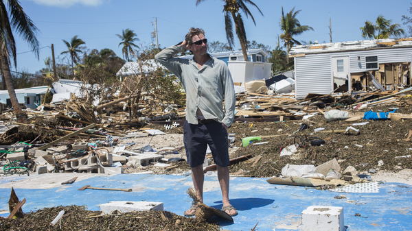 Bill Quinn stands where his home sat in Sea Breeze Mobile Home Community on Tuesday. The home was passed down three generations and had an ocean view. It was destroyed by Hurricane Irma.