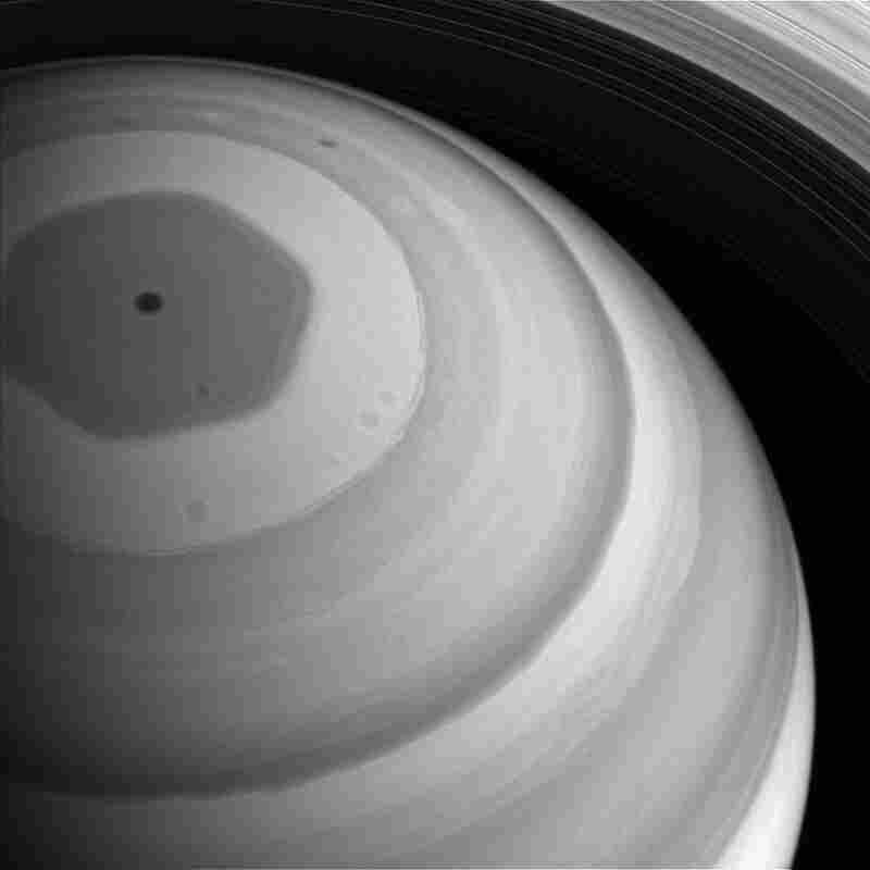"Saturn's polar ""hexagonal storm"" could engulf the entire Earth."