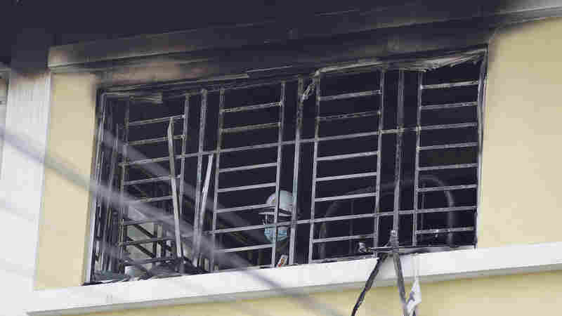 Fire Kills At Least 23 At Malaysian School Dormitory With Barred Windows