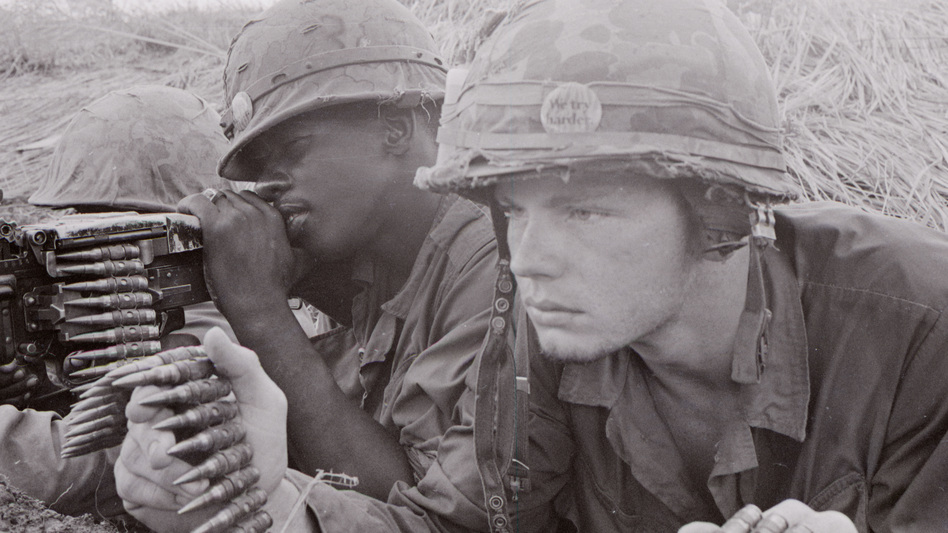 Ken Burns' 10-part, 18-hour series premiers Sunday. Above, an American Marine machine gun crew is poised for action. (Cpl. Aker/PBS)