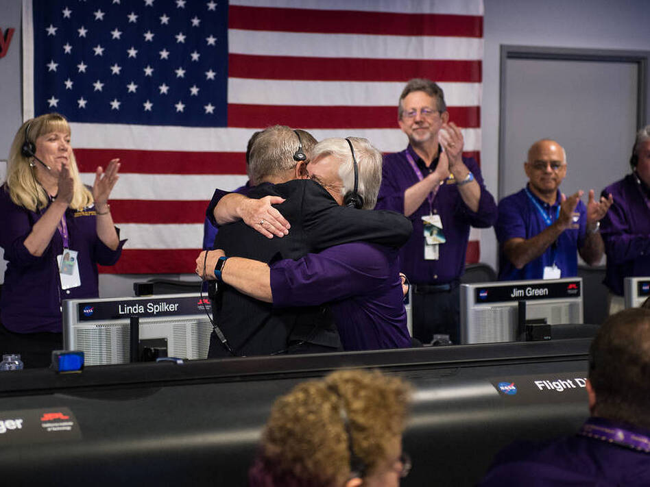 Earl Maize (left), Cassini program manager at JPL, and Julie Webster, spacecraft operations team manager for the Cassini mission at Saturn, embrace after the Cassini spacecraft plunged into Saturn on Friday at precisely 7:55 a.m. ET. (NASA/Joel Kowsky/(NASA/Joel Kowsky))
