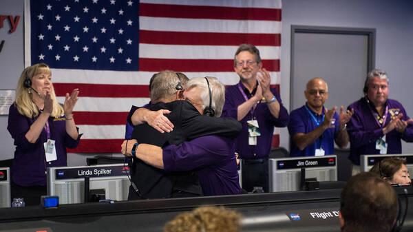 Cassini program manager at JPL, Earl Maize, left, and spacecraft operations team manager for the Cassini mission at Saturn, Julie Webster embrace after the Cassini spacecraft plunged into Saturn, on Friday at precisely 7:55 a.m. ET.