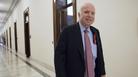 Sen. John McCain, R-Ariz., walks from his Senate office.