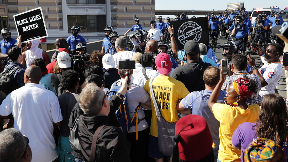 Protesters gather outside the courthouse in downtown St. Louis on Friday, after a judge found a white former St. Louis police officer, Jason Stockley, not guilty of first-degree murder in the death of a black man, Anthony Lamar Smith, who was shot after a high-speed chase in 2011. (Jeff Roberson/AP)