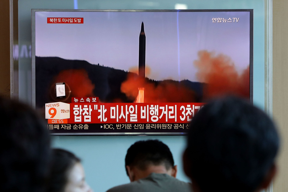 People at the Seoul Railway Station in the South Korean capital watch a TV report on North Korea's missile launch on Friday, days after the U.N. Security Council adopted new sanctions against Pyongyang.