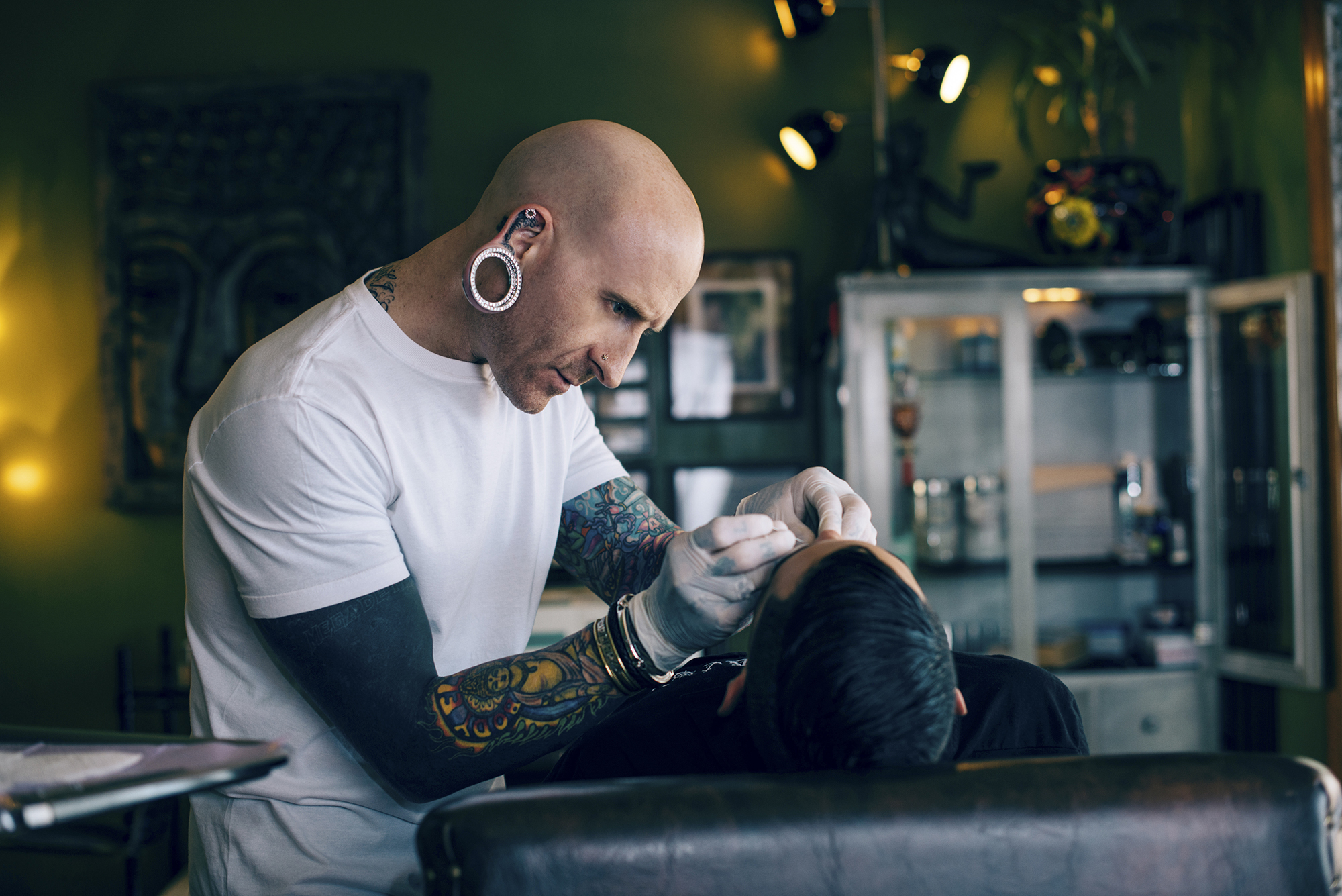 New report cites risks youths face when getting tattoos and piercings