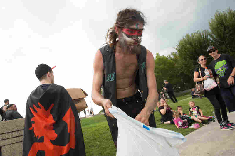 A Juggalo helps collect trash during at the Lincoln Memorial in Washington, D.C., during Saturday's Juggalo March.