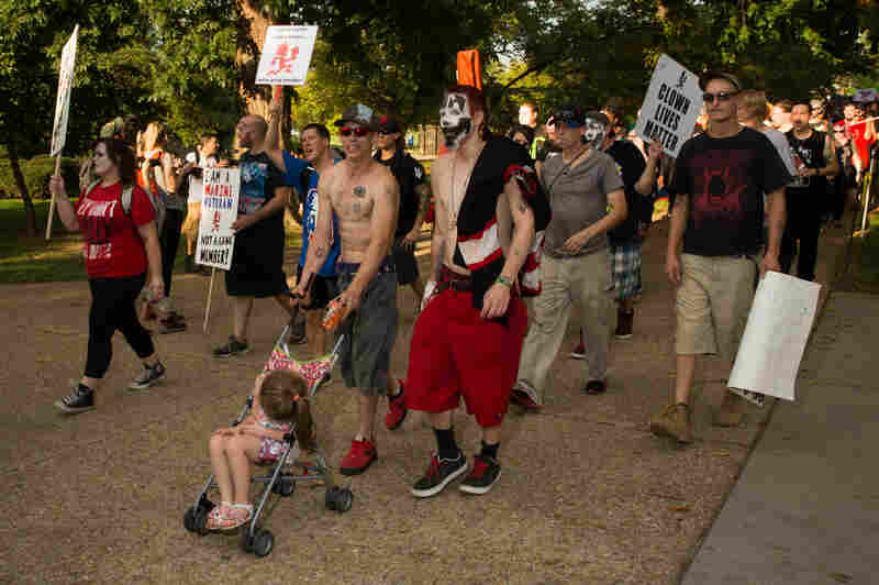 Juggalos brought their families to participate in Saturday's event. Here, the assembly marches following an afternoon of performances and speeches.