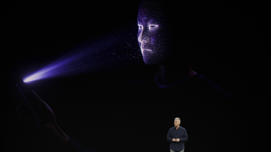 Phil Schiller, Apple's senior vice president of worldwide marketing, announces features of the new iPhone X on Sept. 12 at the Steve Jobs Theater on the new Apple campus in Cupertino, Calif. The phone's new ability to unlock itself using a scan of its owner's face inspired a strong, divided reaction.