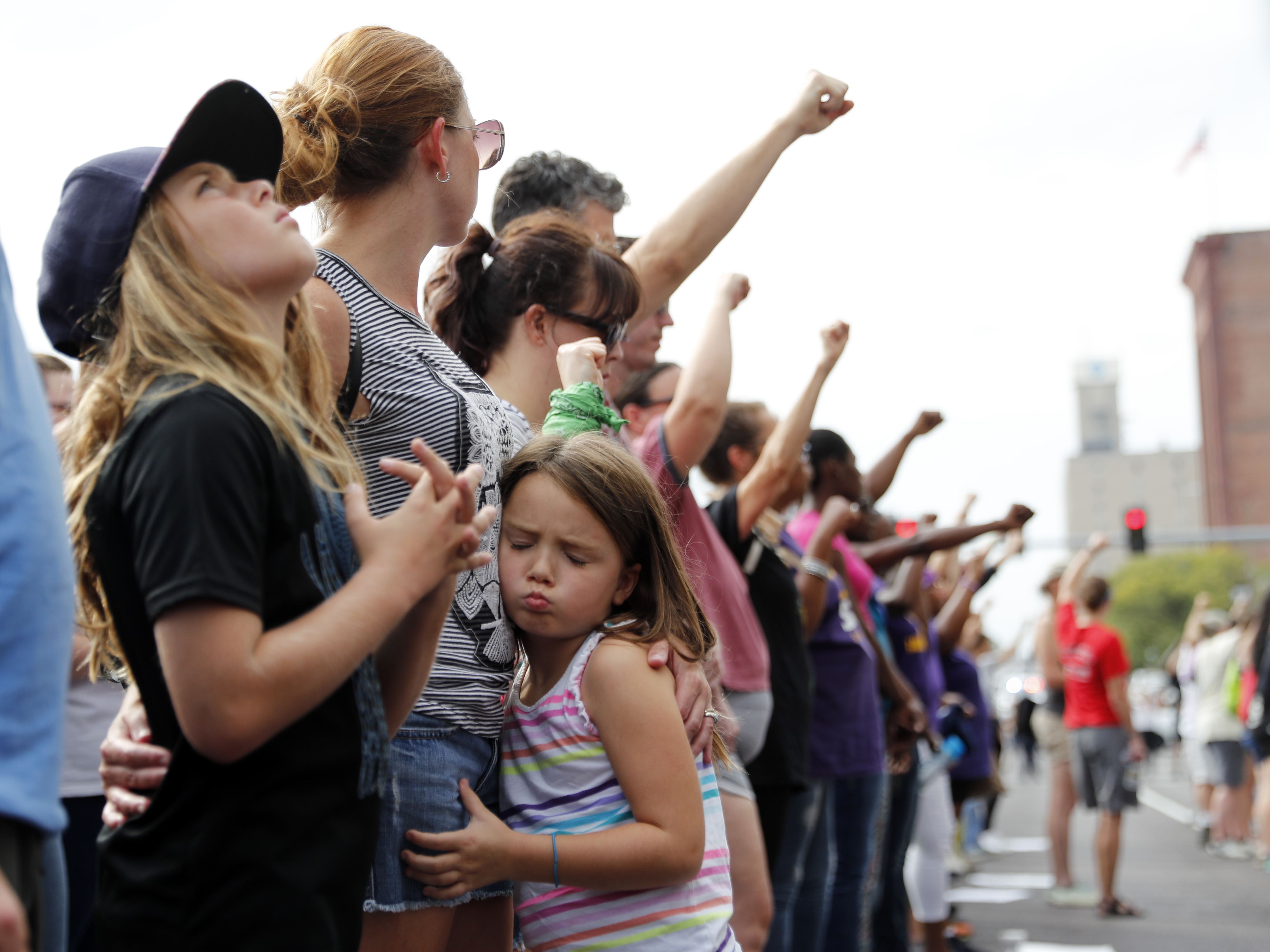 Demonstrations have taken to the streets every day since a white former St. Louis police officer was acquitted Friday in the 2011 killing of a black man. On Saturday, protesters stood silently outside the St. Louis Police Department headquarters. (Jeff Roberson/AP)
