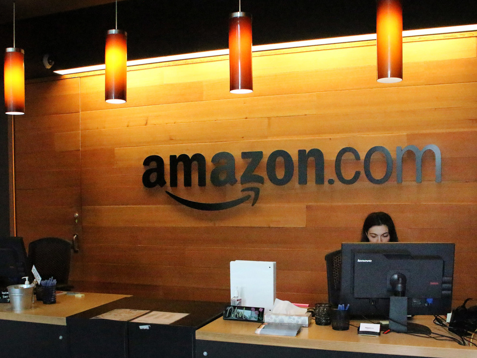 "Nikol Szymul staffs a reception desk at Amazon offices in downtown Seattle. Online retail powerhouse Amazon is searching for a second headquarters location, which an official from Toronto has called ""the Olympics of the corporate world."" (Glenn Chapman/Getty Images)"