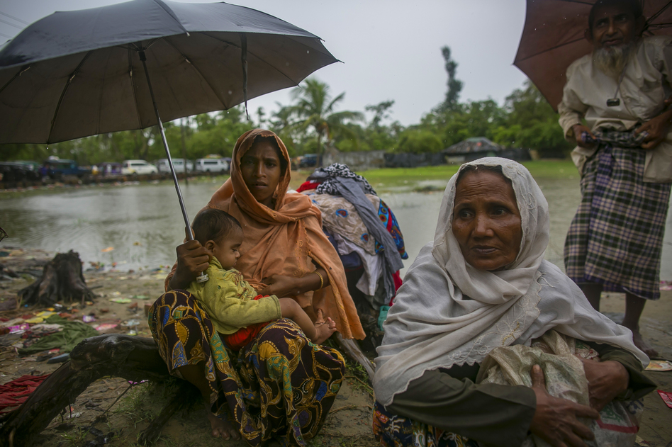 Rohingya refugees arrive in Bangladesh on Sunday. They are fleeing government violence in Myanmar. (Allison Joyce/Getty Images)