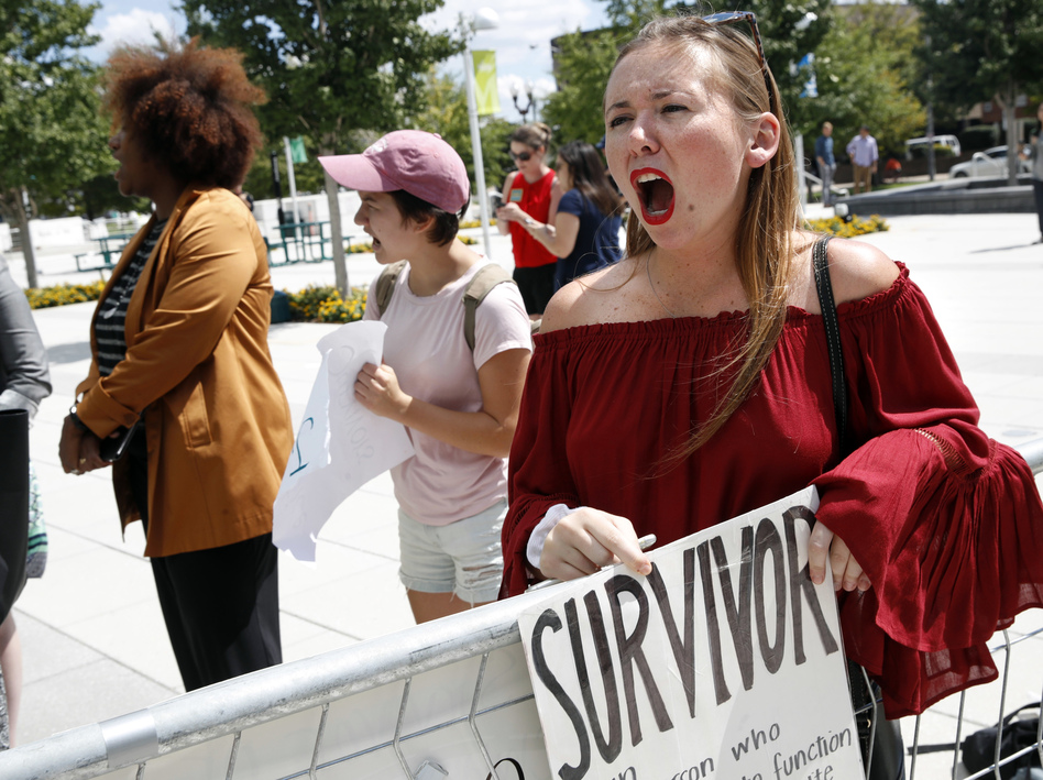 Meghan Downey, 22, a recent graduate from the College of William & Mary, protests outside an Arlington, Va., auditorium after Education Secretary Betsy DeVos spoke about campus sexual assault. (Jacquelyn Martin/AP)