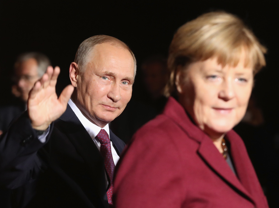 President Vladimir Putin's Russia appears to have meddled less in the German elections, in which Chancellor Angela Merkel is expected to retain power, than in other countries' recently. (Sean Gallup/Getty Images)