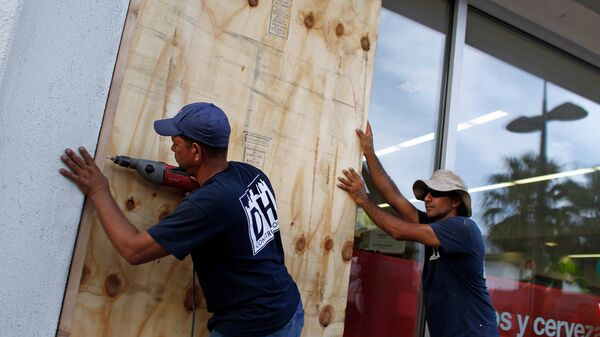 People board up windows on Monday in preparation for the anticipated arrival of Hurricane Maria in San Juan, Puerto Rico.