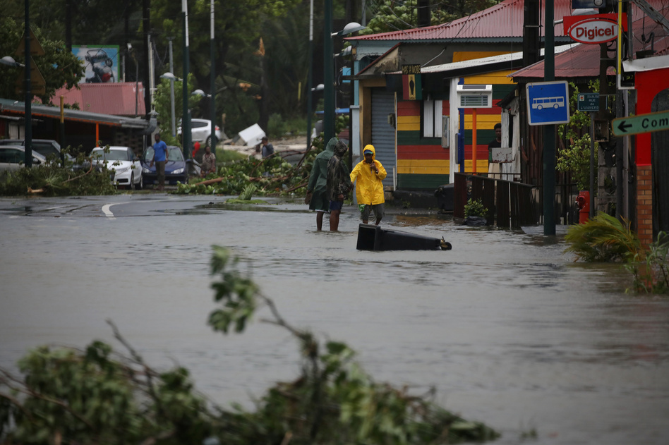 Hurricane Maria has already left the streets flooded in Pointe-à-Pitre, Guadeloupe, on Tuesday. (Andres Martinez Casares/Reuters)