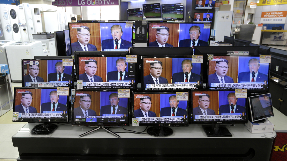 TV screens at a store in Seoul, South Korea, show news coverage of the latest exchange of insults between President Trump and North Korean leader Kim Jong Un. (Ahn Young-joon/AP)