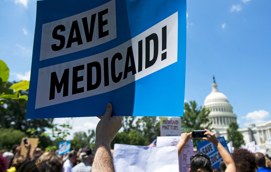 Protesters rally against Medicaid cuts in front of the U.S. Capitol in June. Medicaid is the nation's largest health insurance program, covering 74 million people — more than 1 in 5 Americans. (Bill Clark/CQ Roll Call/Getty Images)