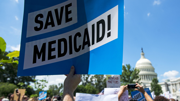 Protesters rallied against Medicaid cuts in front of the U.S. Capitol in June. Medicaid is the nation