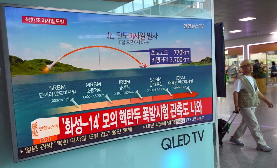 A screen at a railway station in Seoul on Friday shows a news graphic of a North Korean missile launch. President Trump said on Thursday there would be additional sanctions on North Korea. (Jung Yeon-Je/AFP/Getty Images)