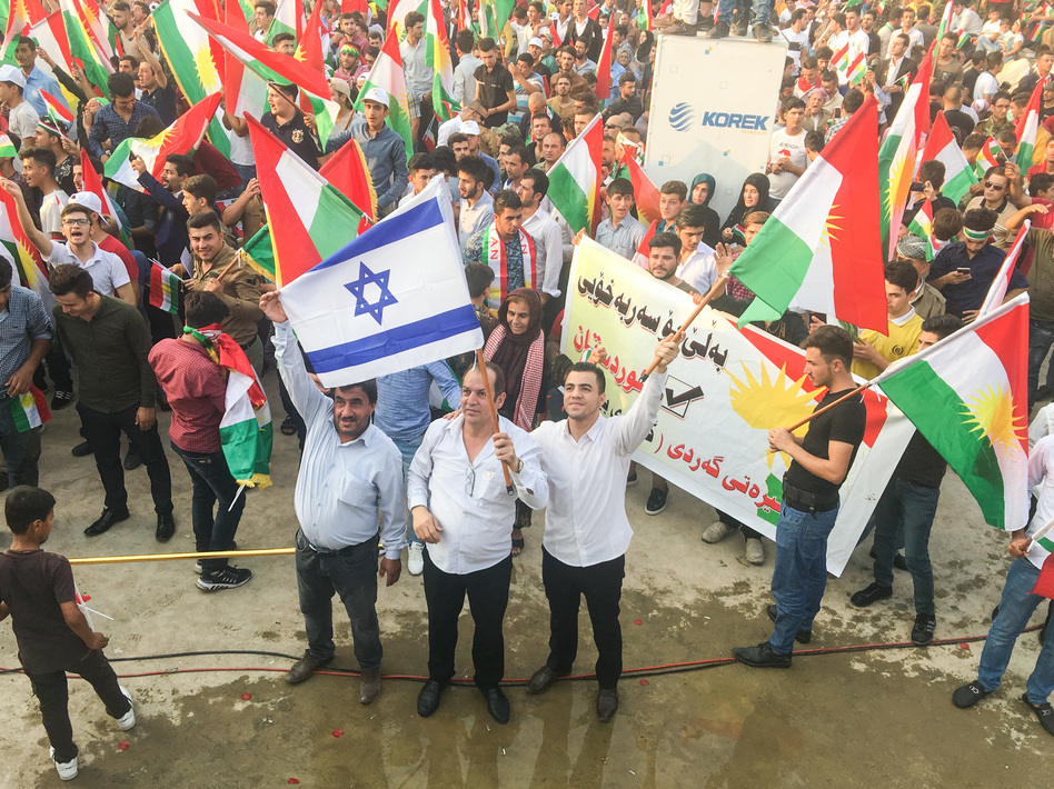 Kurds wave Israeli flags at a Kurdish independence rally. Israel is the only country in the region to support the referendum. (Jane Arraf/NPR)
