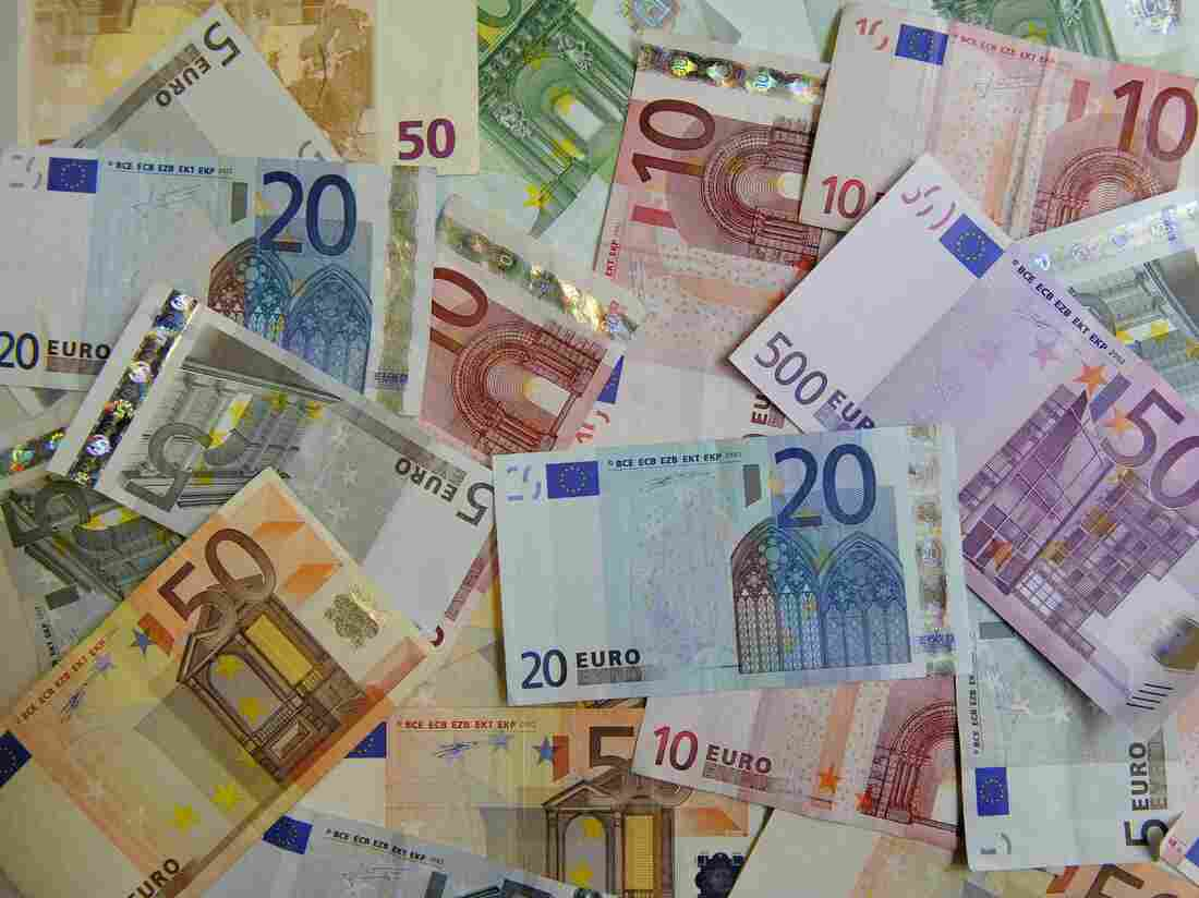 Euro bank notes lie on a table in counter of a bank in Dresden, Germany, Monday, June 22, 2009. (AP Photo/Matthias Rietschel)