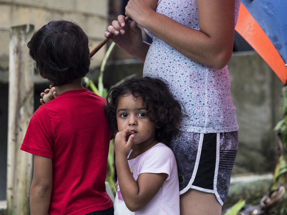 Three-year-old Deyanery Ramirez is in the La Perla neighborhood of San Juan, Puerto Rico, on Thursday. Without cell service on the island, it has been difficult for people to check on their loved ones. (Alex Wroblewski/Getty Images)