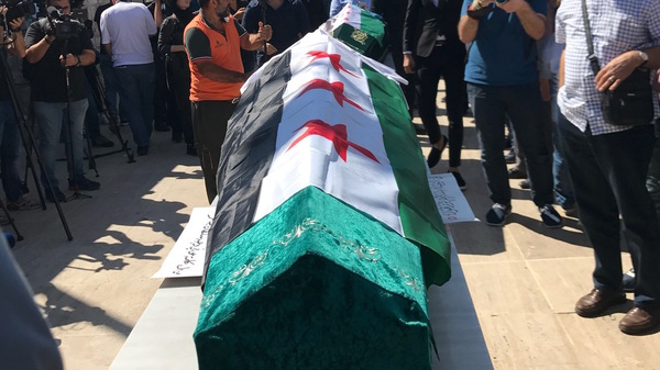 The caskets of slain mother and daughter Orouba and Halla Barakat are prepared for the funeral Saturday in Istanbul.