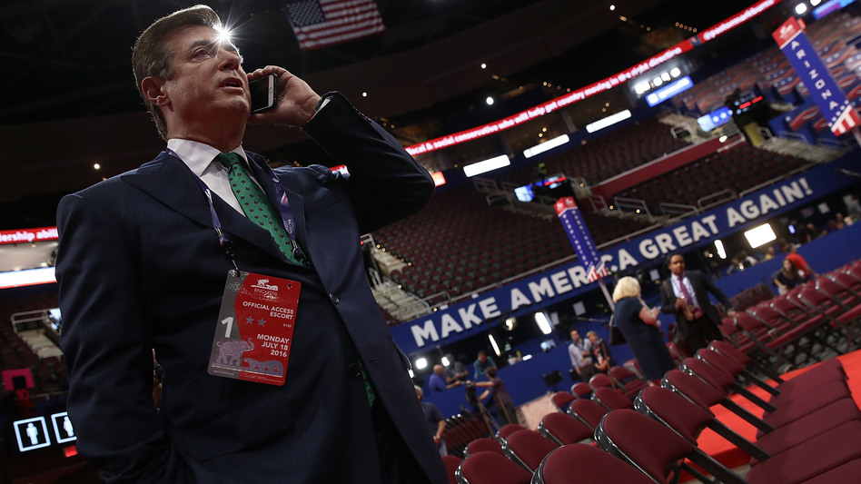 Paul Manafort speaks on the phone while touring the floor of the Republican National Convention on July 17, 2016, in Cleveland, Ohio. (Win McNamee/Getty Images)