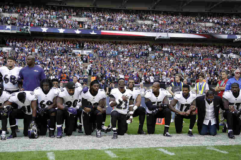 Baltimore Ravens players, including former player Ray Lewis (second from right), kneel during the national anthem before a game against the Jacksonville Jaguars at Wembley Stadium in London on Sunday.