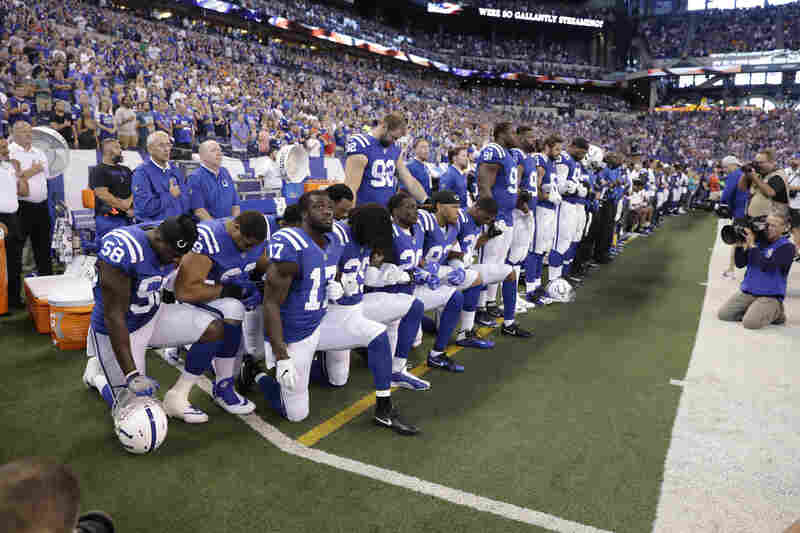 Members of the Indianapolis Colts take a knee during the nation anthem before playing the Cleveland Browns in Indianapolis on Sunday.