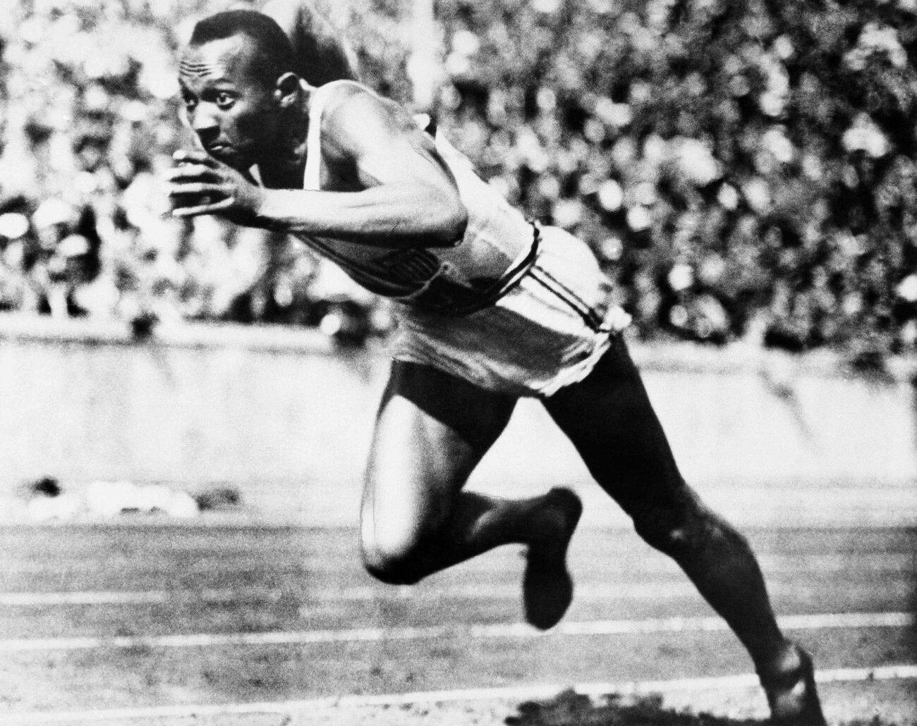 Jesse Owens competing in one of the heats of the 200-meter run at the 1936 Olympic Games in Berlin. Owens won four gold medals at games in front of Hitler. (AP)