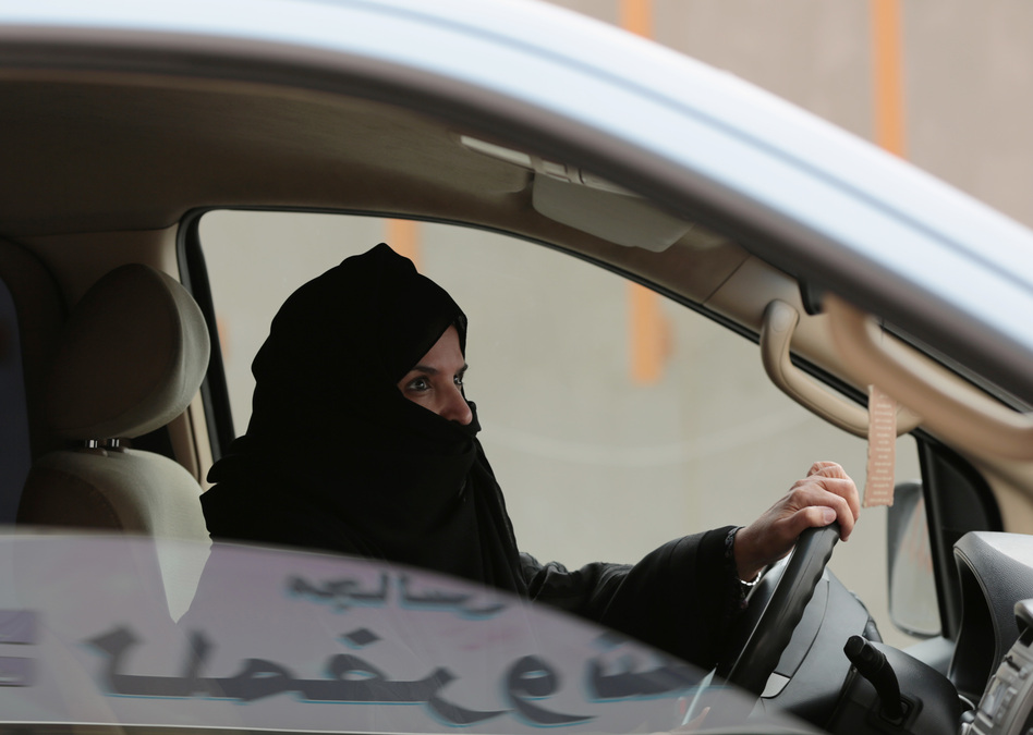 A Saudi woman drives on a highway in 2014 in Riyadh, Saudi Arabia, as part of a campaign to defy the country's ban on women driving. (Hasan Jamali/AP)