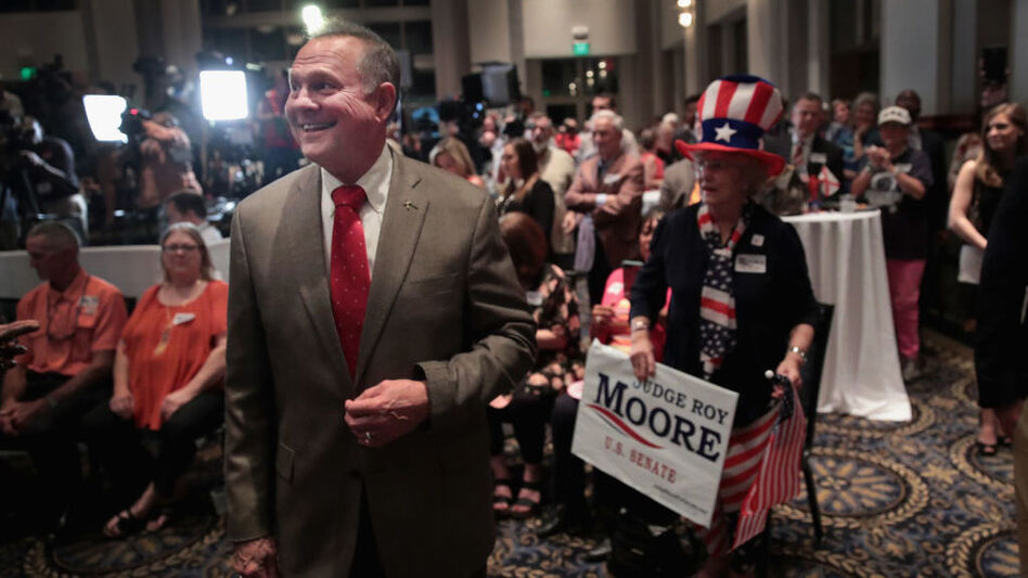 Alabama GOP Senate nominee Roy Moore greets supporters at his victory party on Tuesday night. (Scott Olson /Getty Images)
