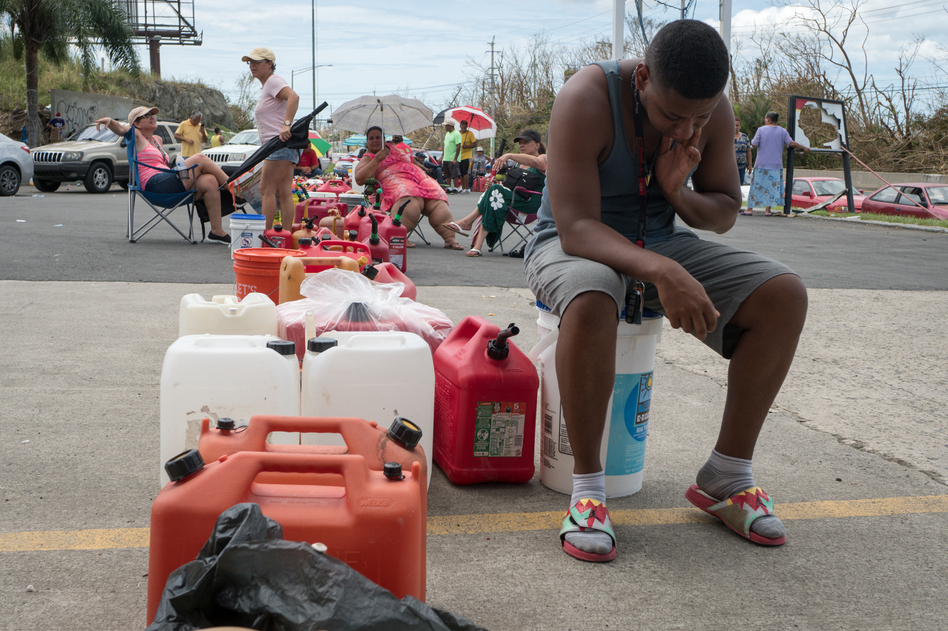 People have been waiting in line inside cars and on foot with gas canisters since before sunrise on Monday in Rio Grande, Puerto Rico. (Angel Valentin for NPR)