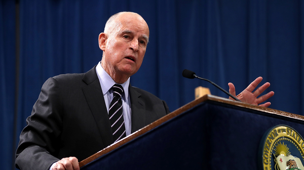 California Gov. Jerry Brown signed the bill to move up primary elections without comment.