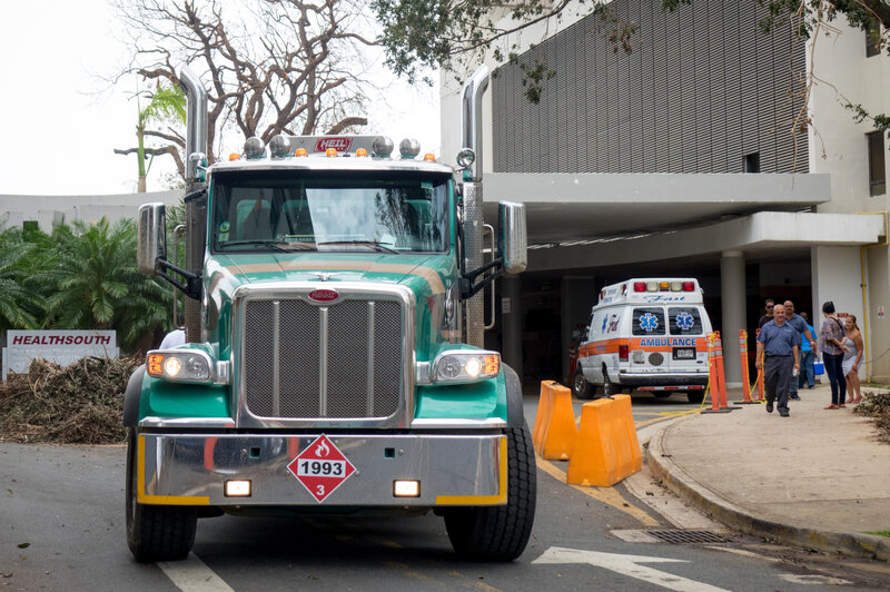 A truck hauling diesel leaves the University of Puerto Rico's Medical Center, which is operating on diesel-powered generators following Hurricane Maria. (Angel Valentin for NPR)