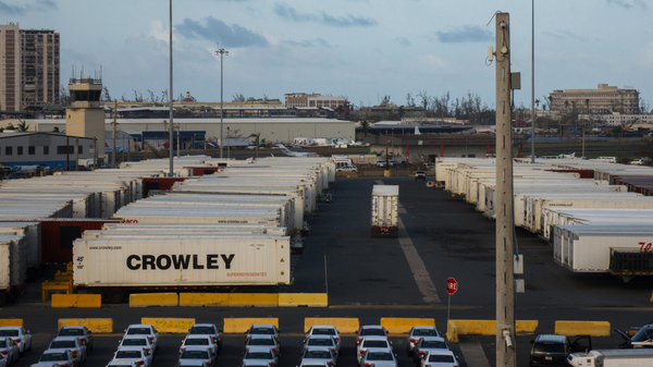 Crowley shipping containers with running refrigeration systems are lined up at in the port of San Juan, Puerto Rico. They