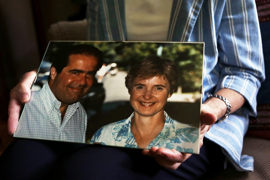 Maureen Scalia holds one of her favorite photos of her and her husband, the late Supreme Court Justice Antonin Scalia, in their home in Virginia. (Jennifer Kerrigan/NPR)