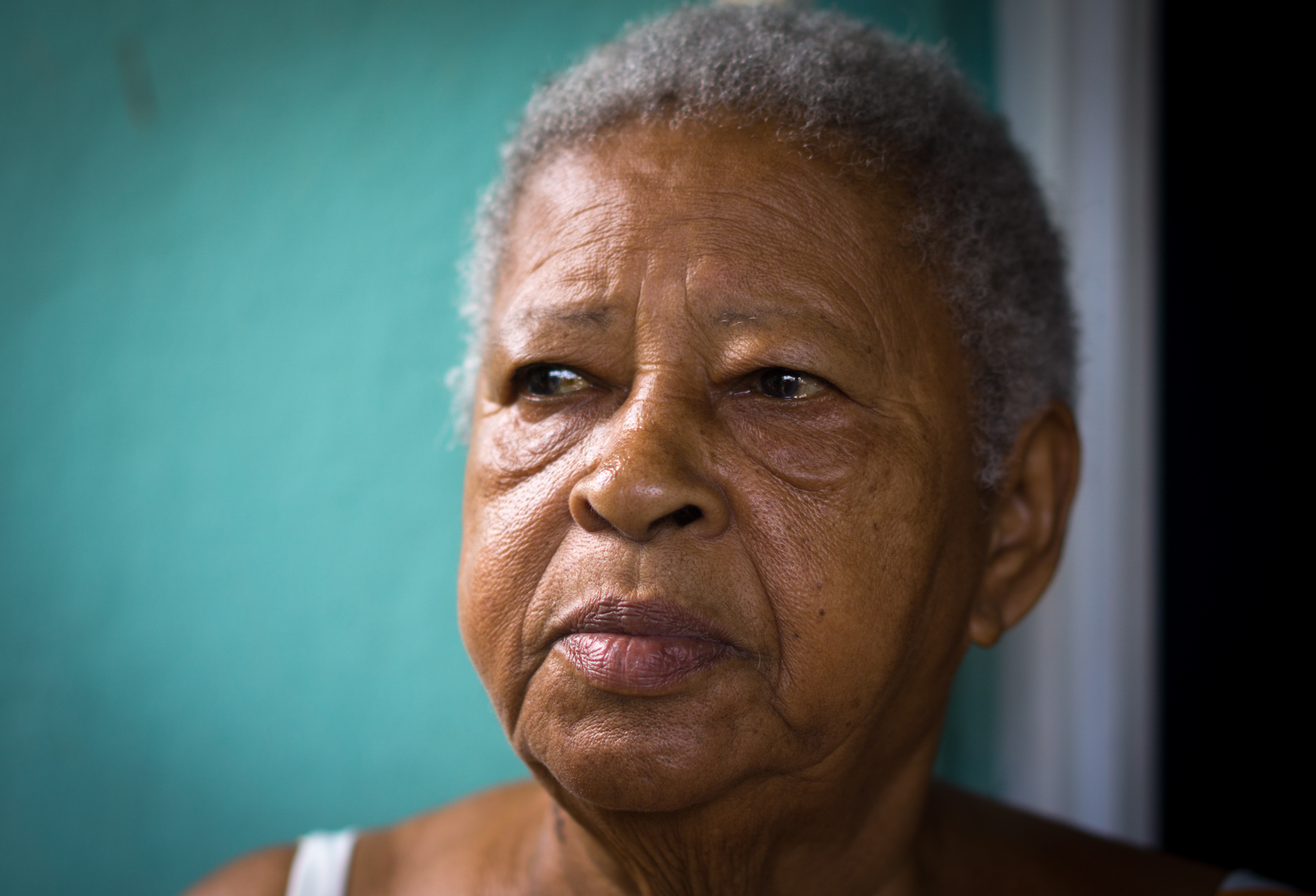 Rafaela Pizarro Parrilla, 82, suffers from diabetes, was admitted to the hospital after the storm because of low blood sugar. Her daughter and caretaker, Maria, is concerned about the lack for electricity in Playita and is considering moving Rafaela to the mainland. (Angel Valentin for NPR)